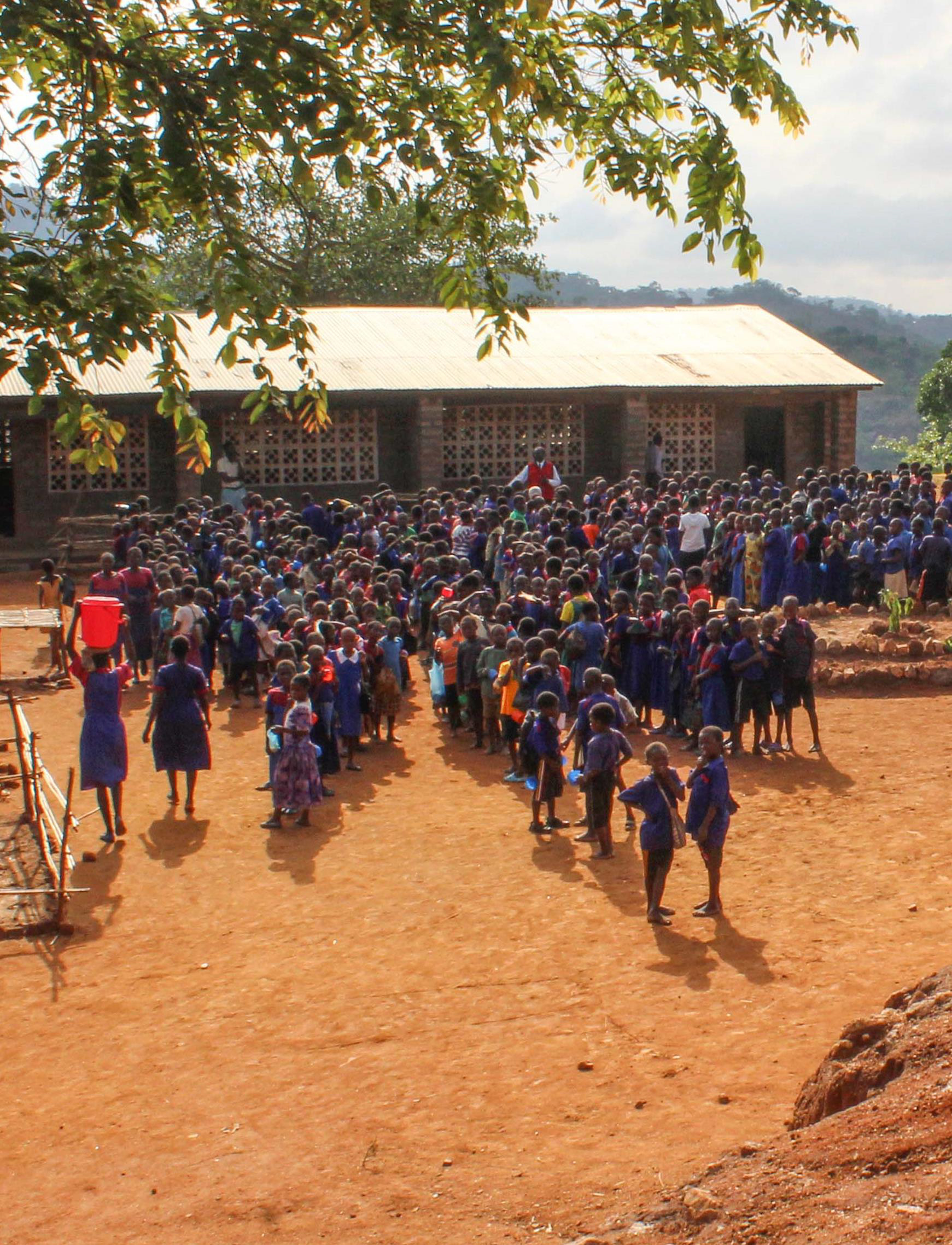 Students in front of school Africa