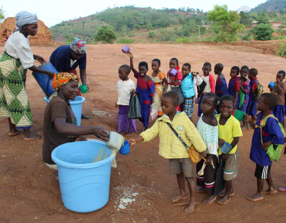 Small children getting water in Africa